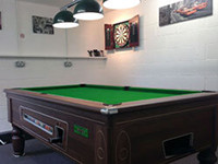 Relax inside with the snooker table and dart board